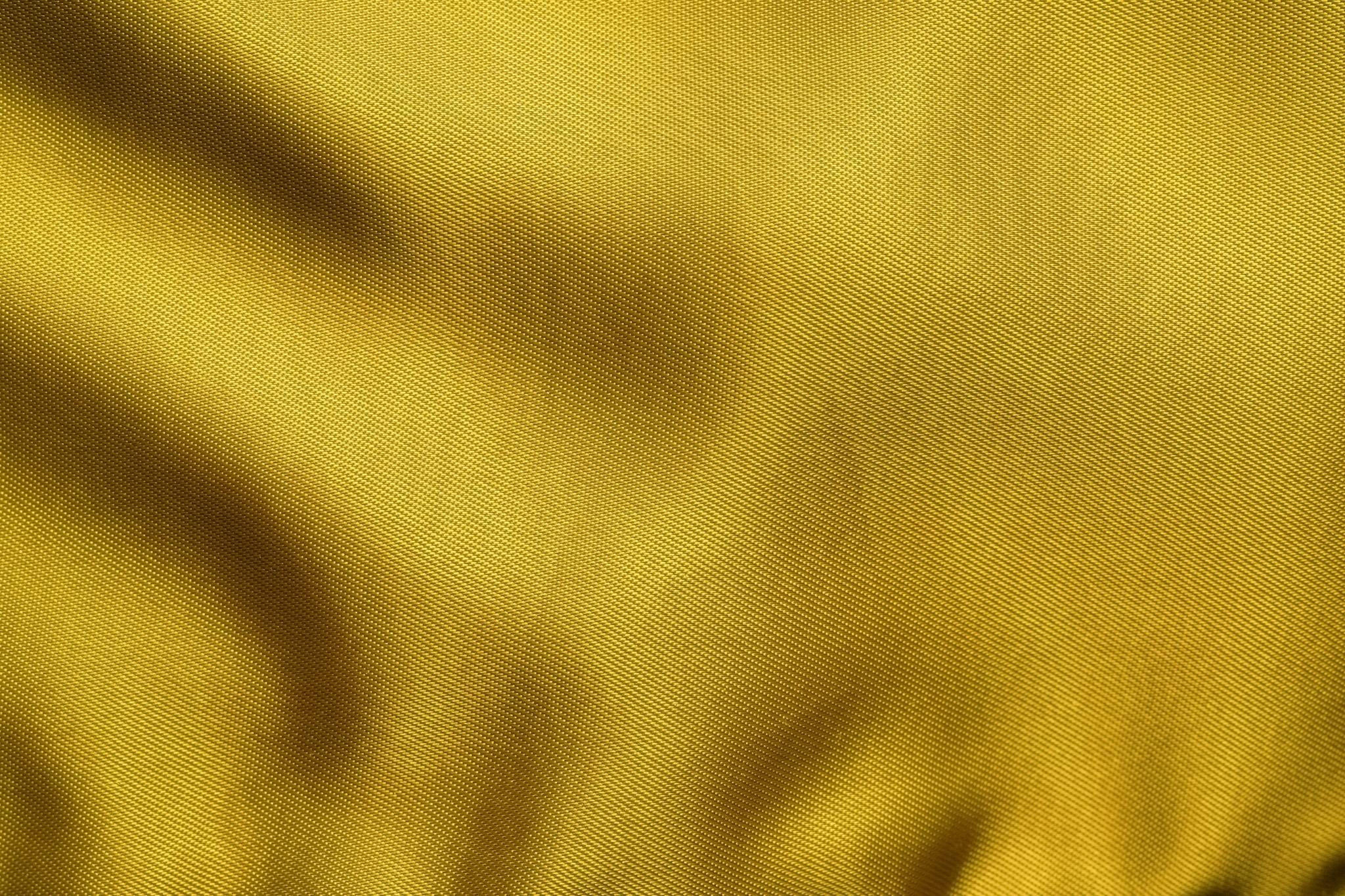 「金色の高級感ある生地のテクスチャ」
