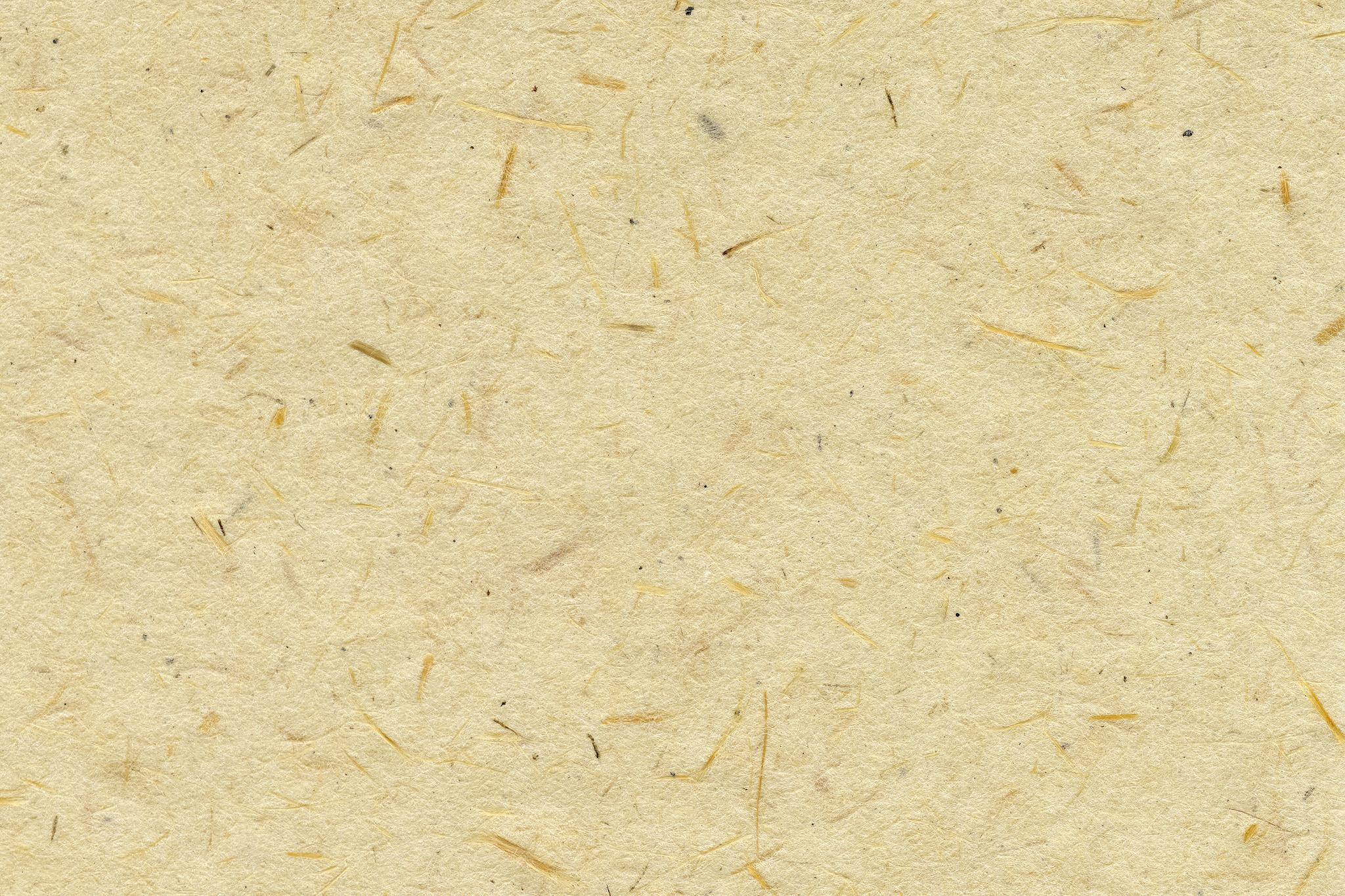 「繊維の入った生成り色の和紙」の画像を無料ダウンロード