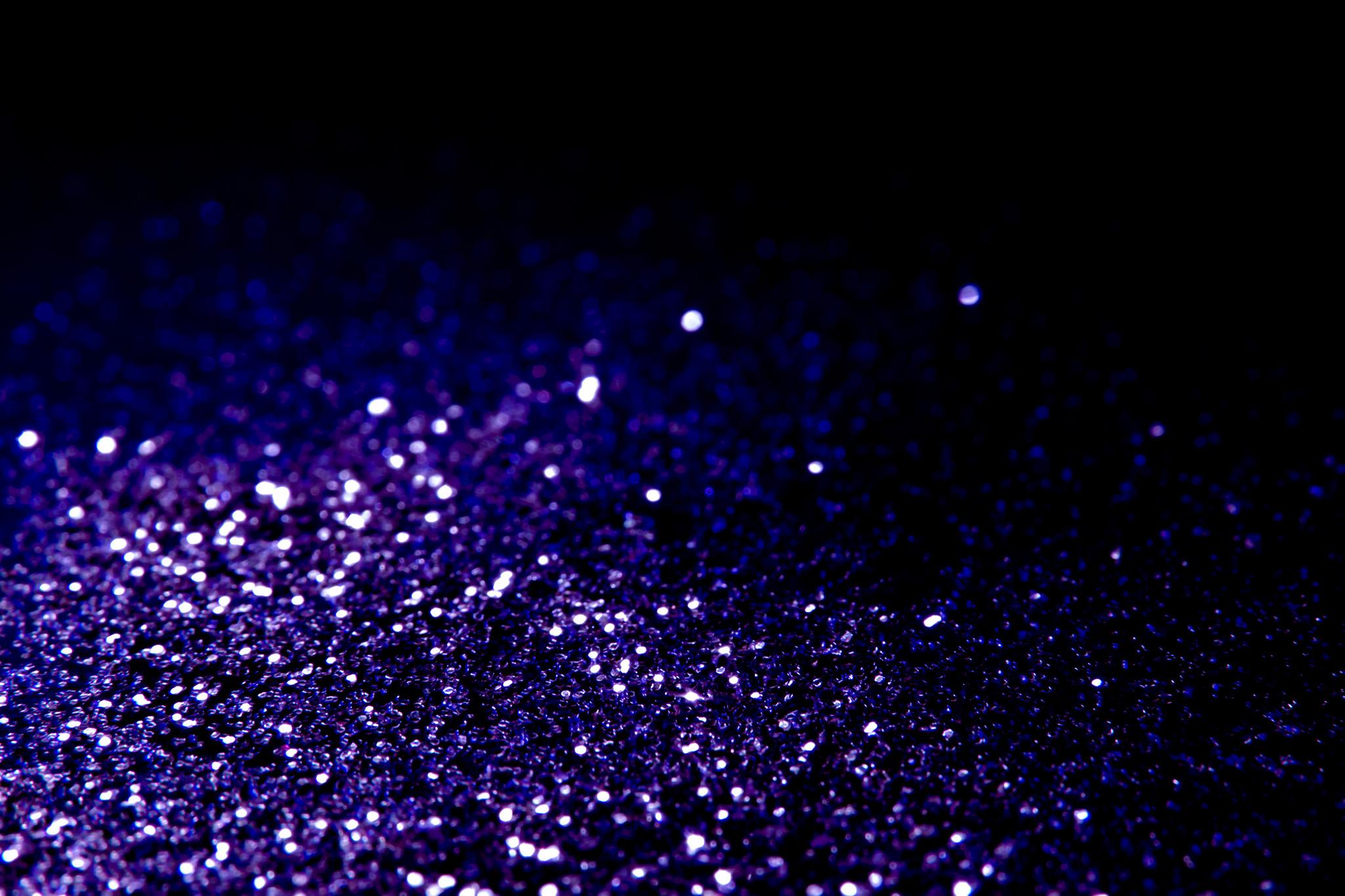「紫色の光の粒」の背景を無料ダウンロード