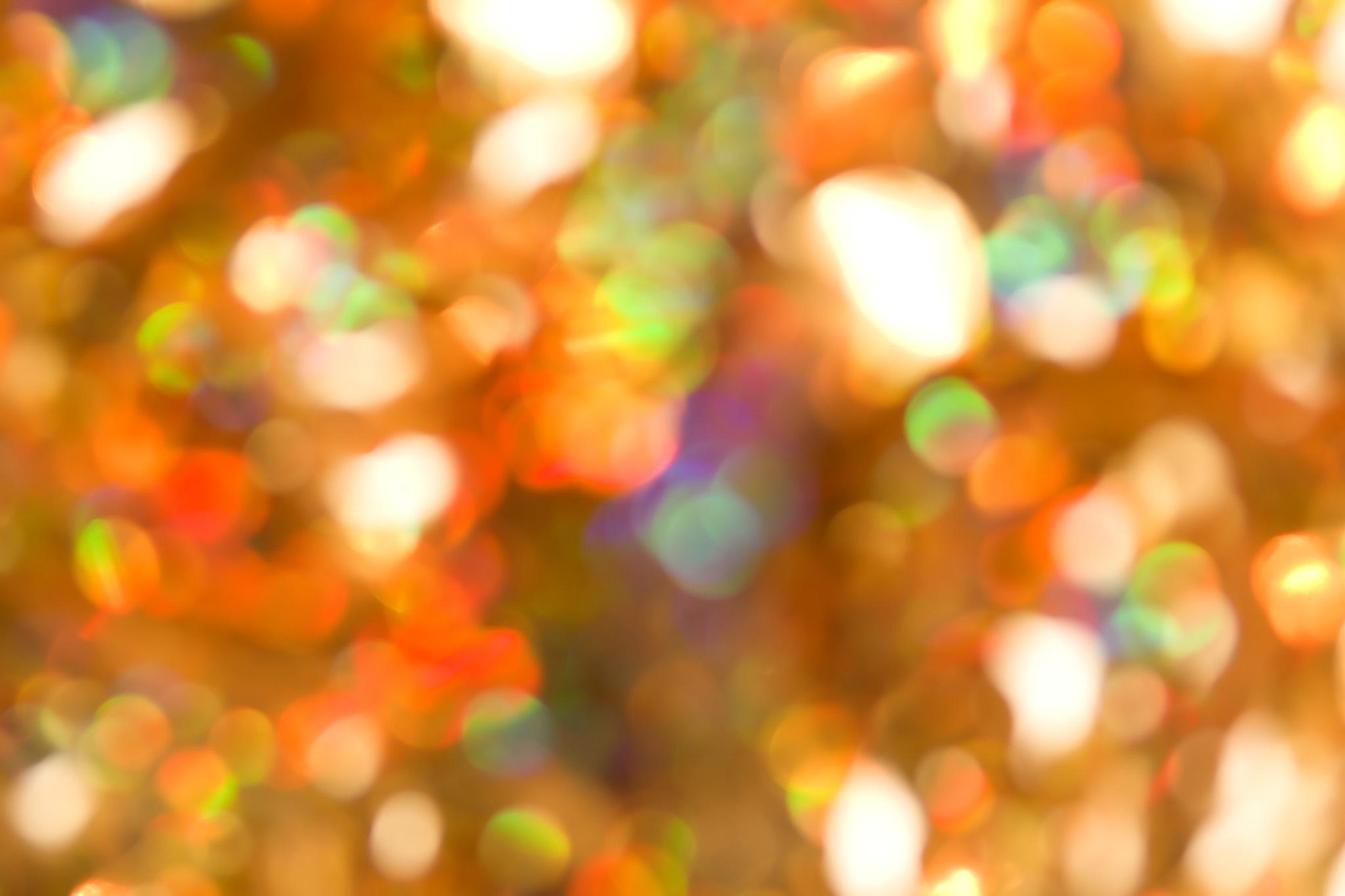 「カラフルな光のボケ」の背景を無料ダウンロード