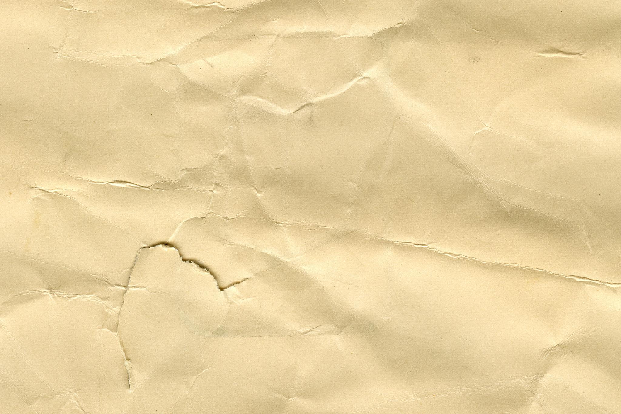 「傷ついた茶色い紙のテクスチャ」