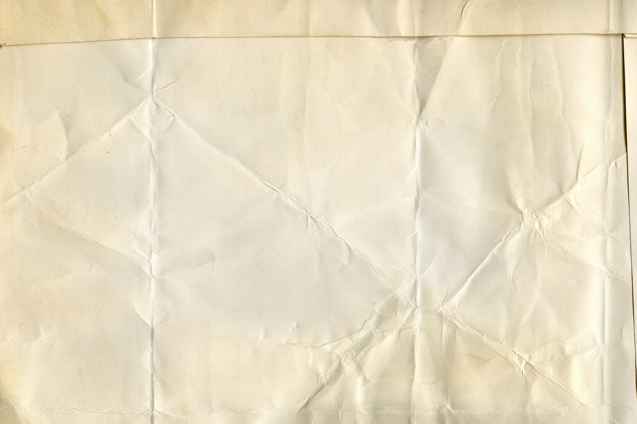 「古い紙の折れ目や皺」