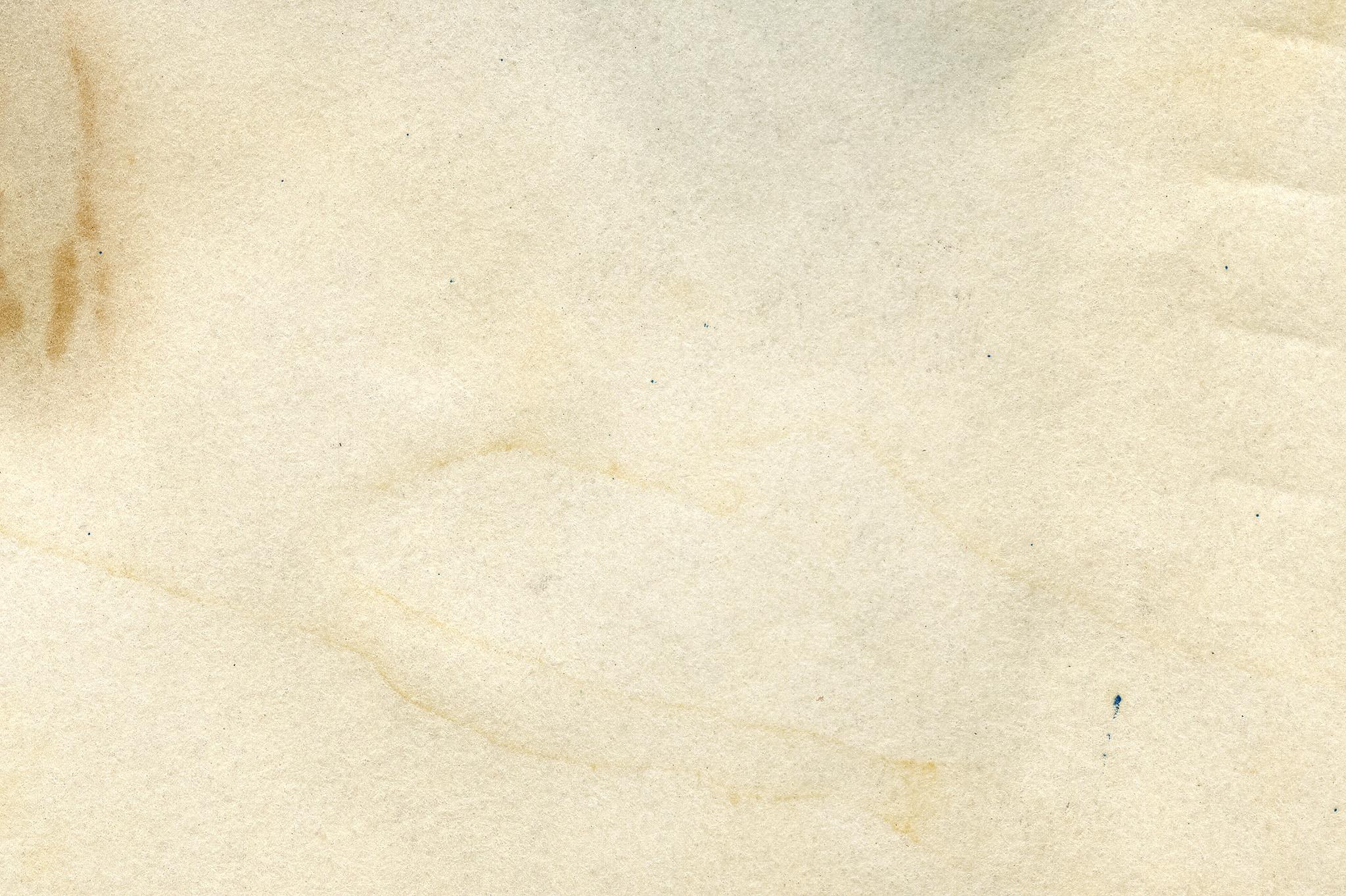 「シミや汚れがある古紙のテクスチャ」