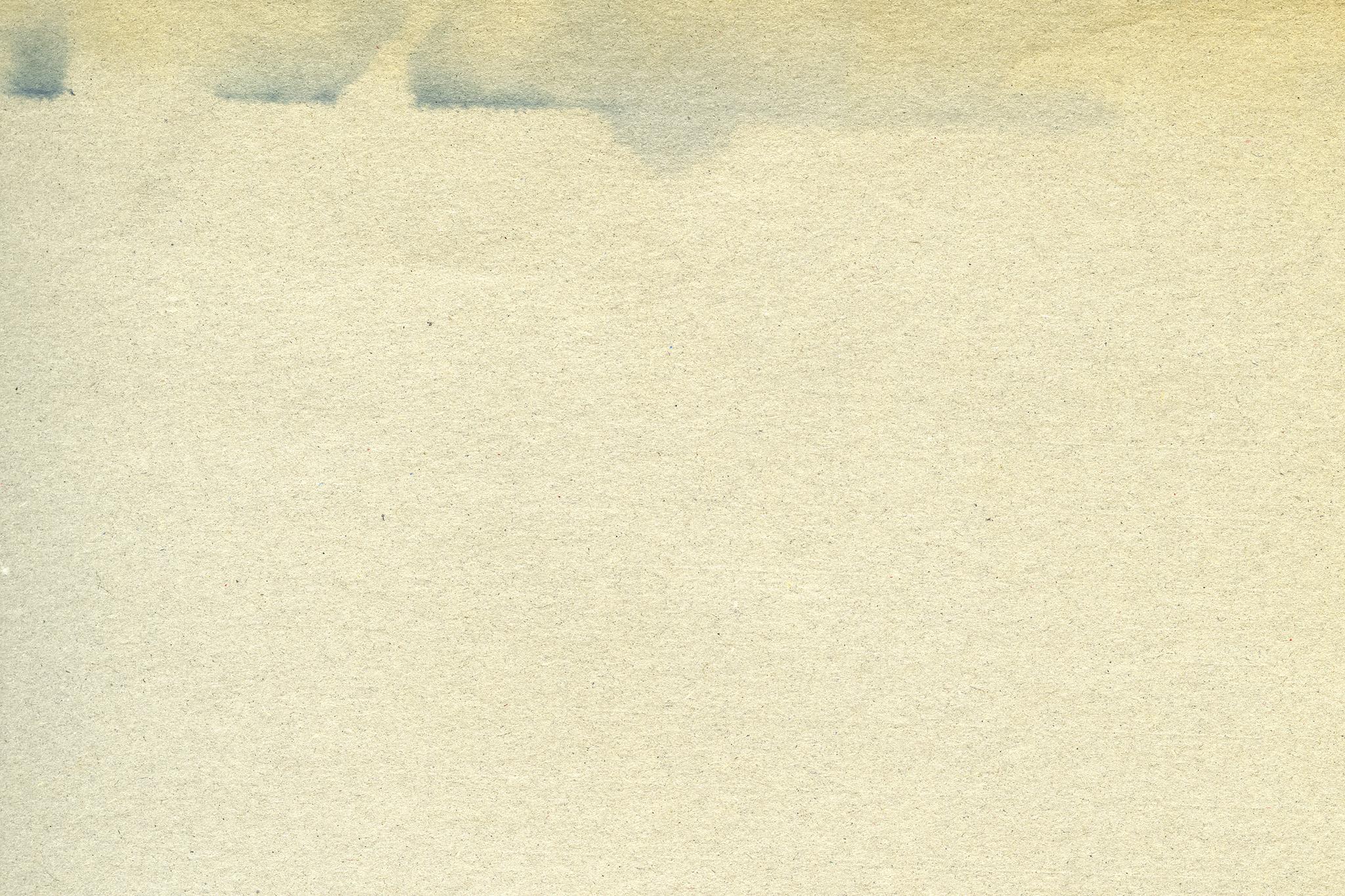 「インクの滲んだ様なシミのある紙」