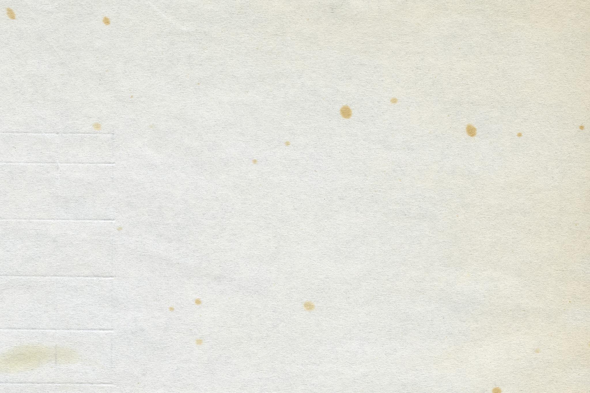 「所々にシミのある古い紙」の素材を無料ダウンロード