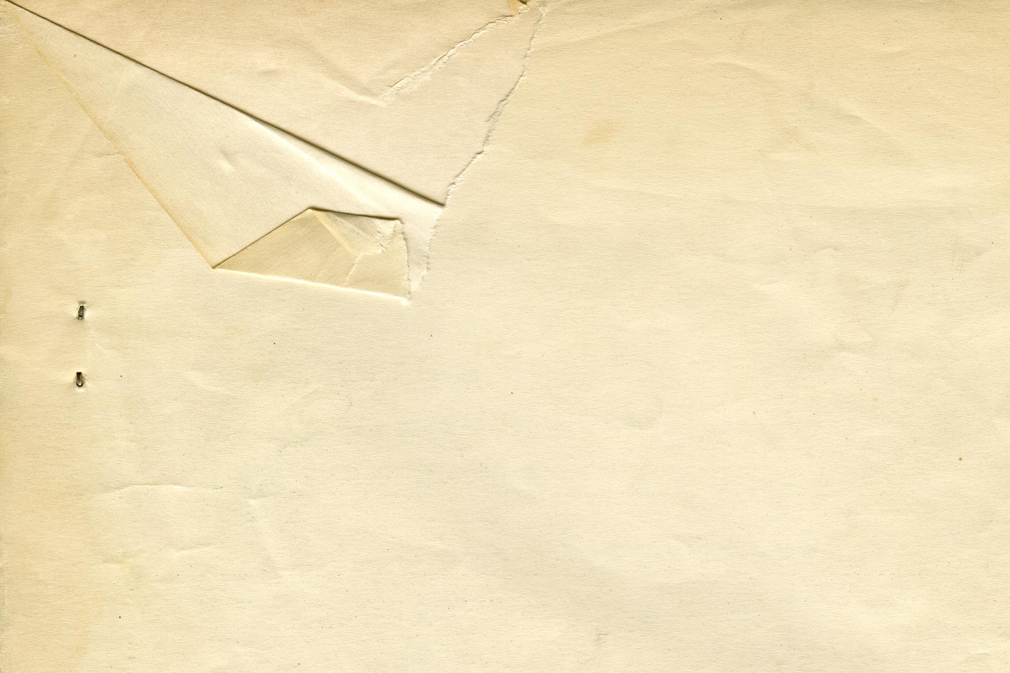 「レトロな破けた紙のテクスチャ」