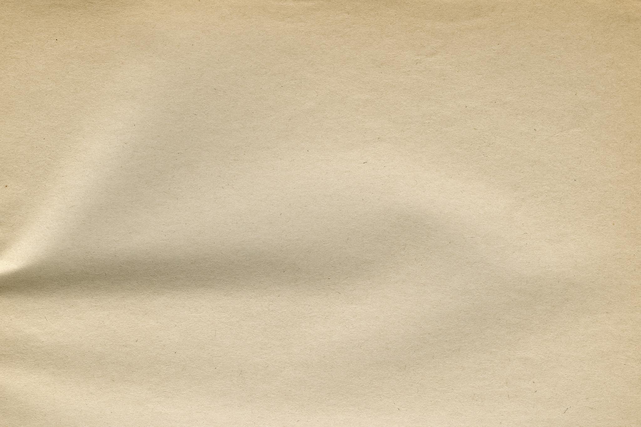 「シワのある古紙のテクスチャ」