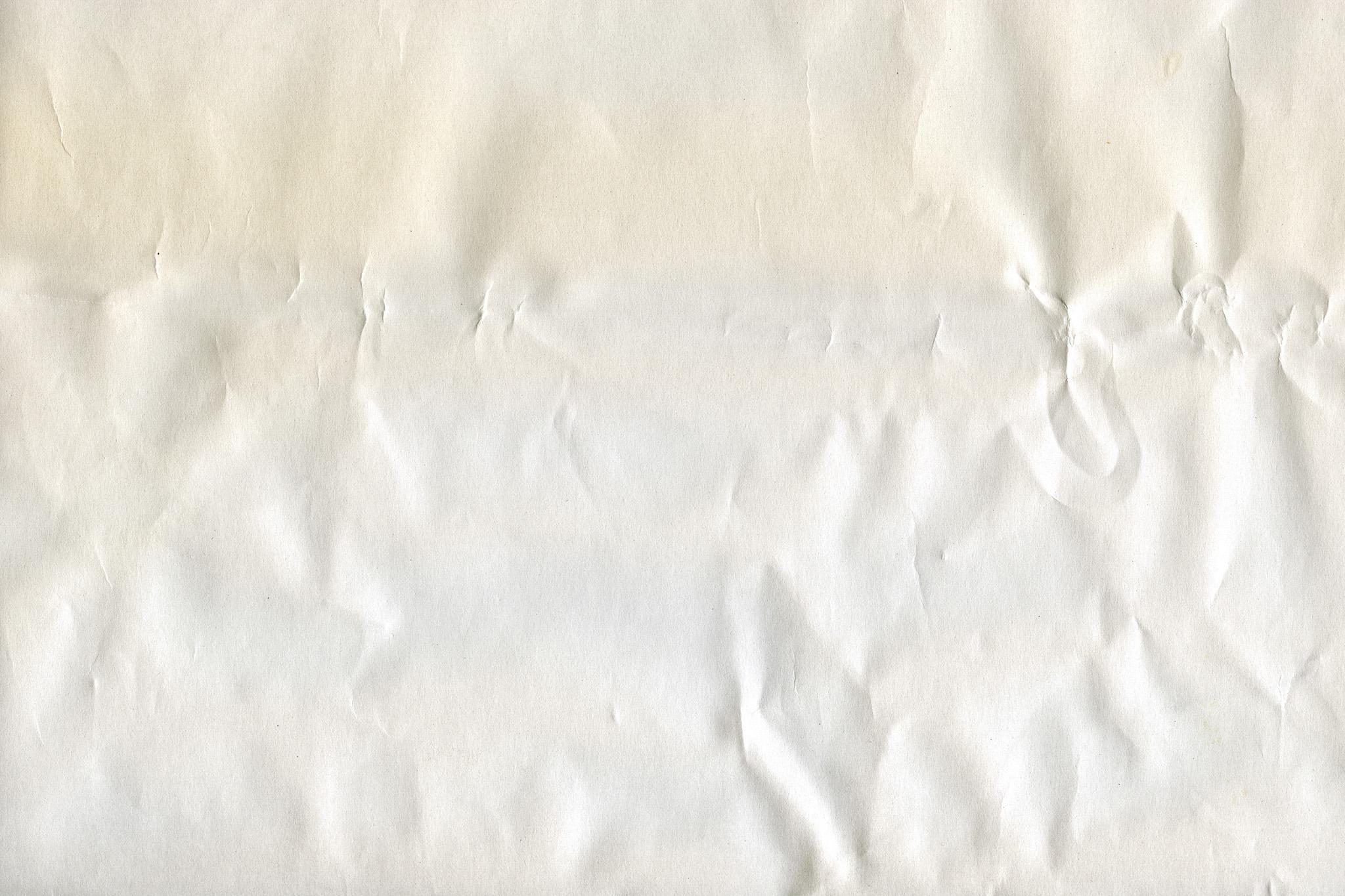 「シワがある紙の背景素材」