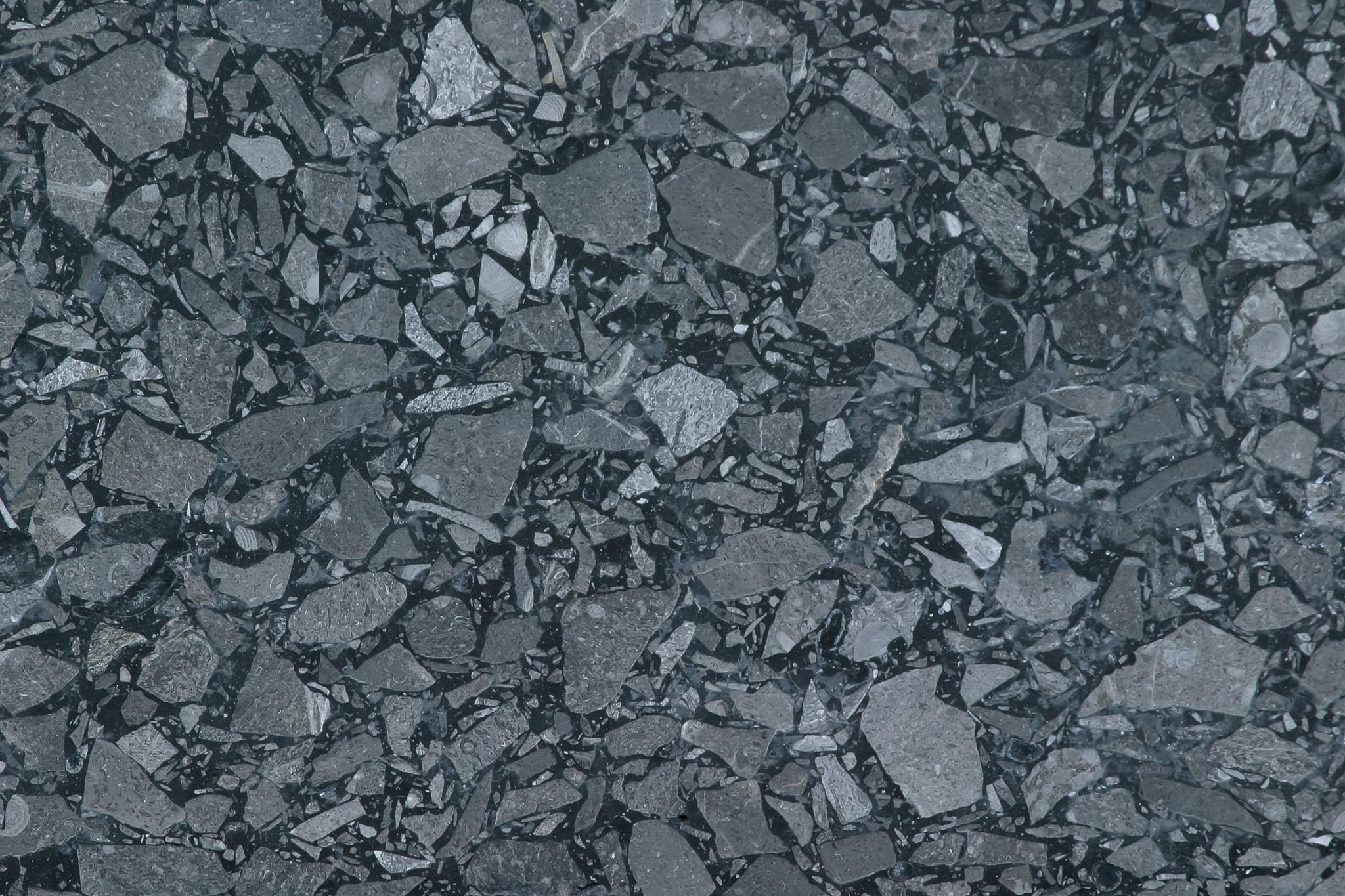 「小さな石が敷き詰められた背景」のテクスチャを無料ダウンロード