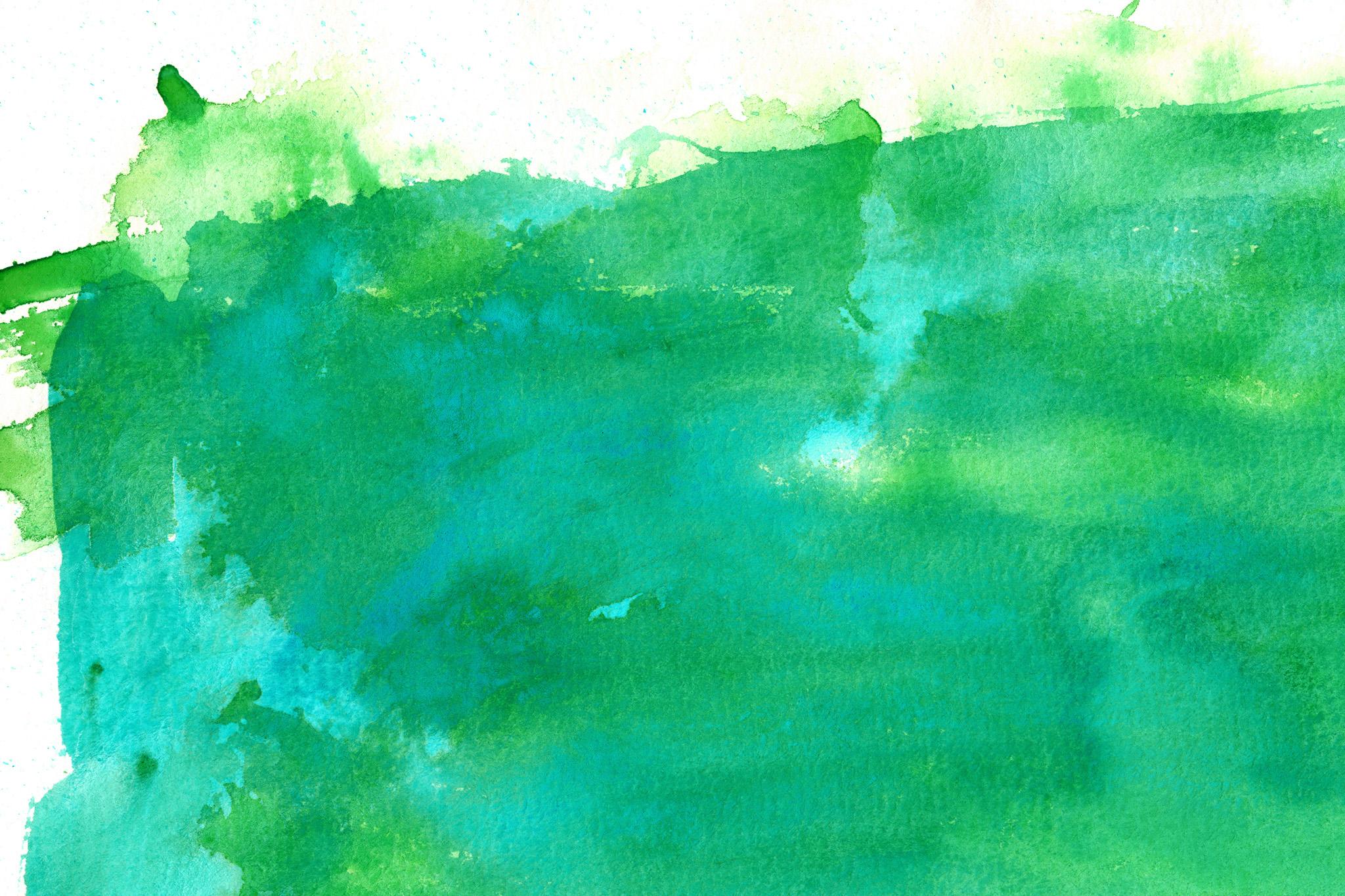 「緑の水彩絵具の滲むテクスチャ」