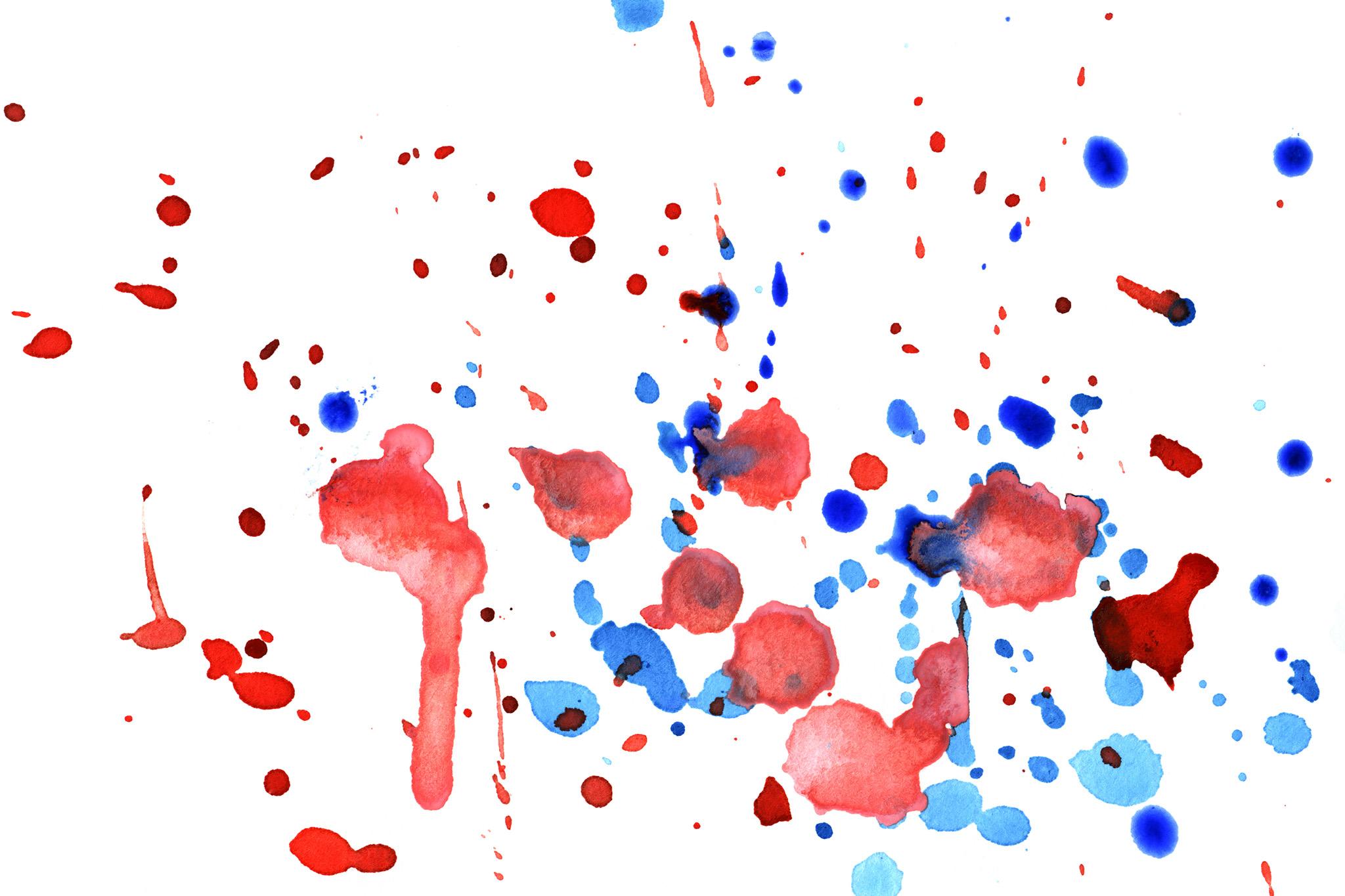 「白い紙に落ちた赤と青の絵具」