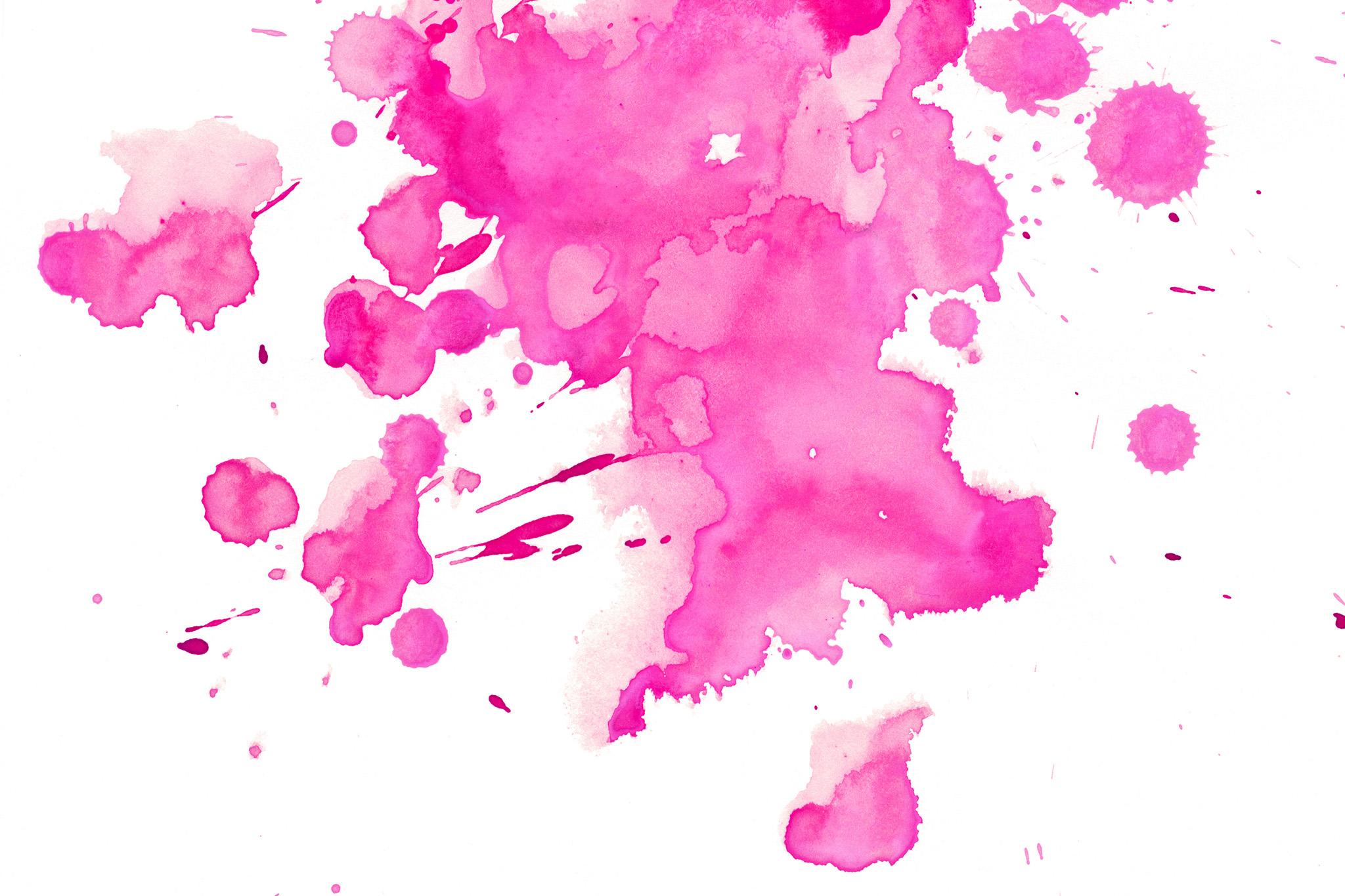 「ピンクの水彩絵具の滲みと飛沫」