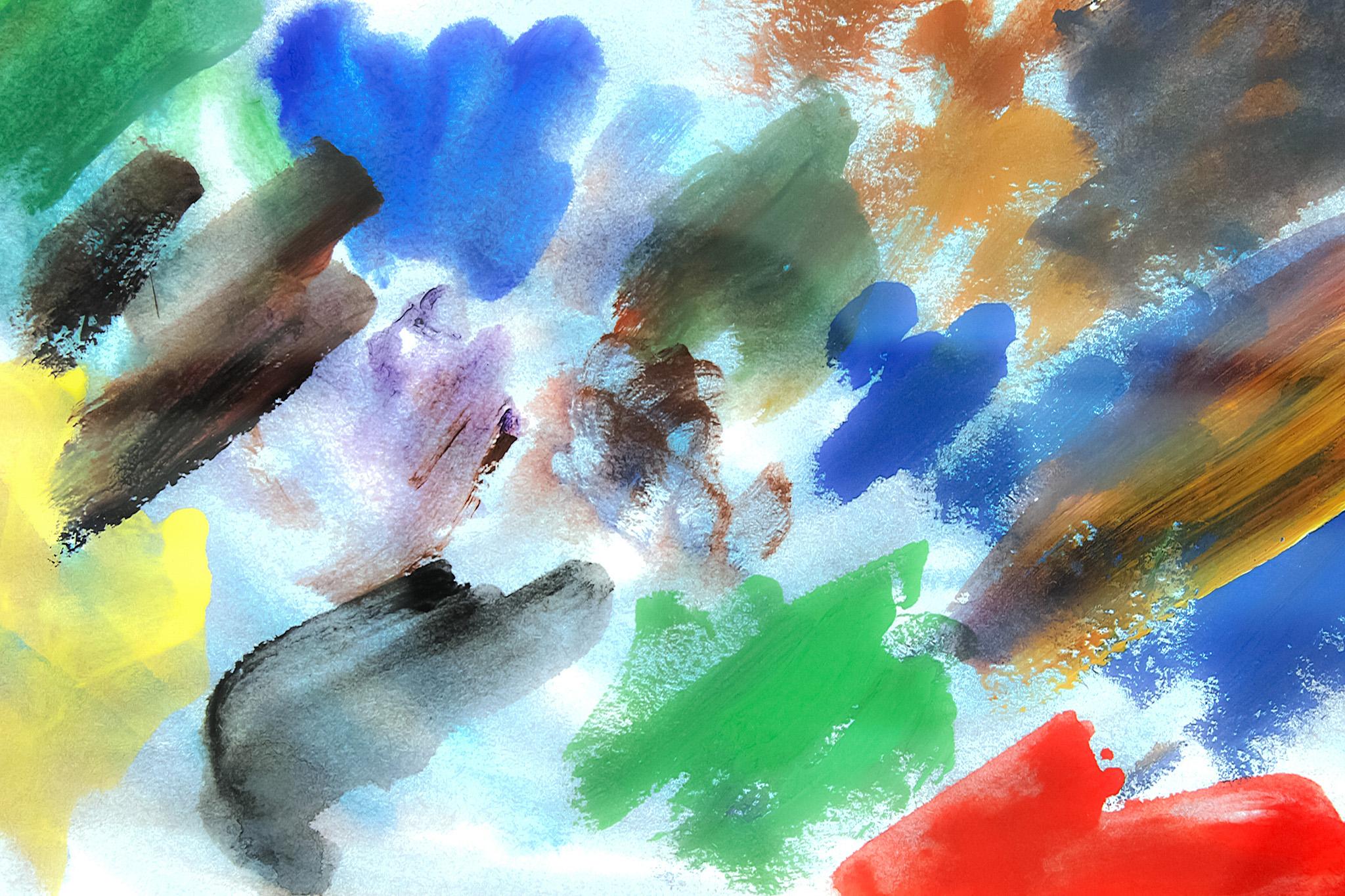 「筆で薄く塗った多色の水彩絵具」