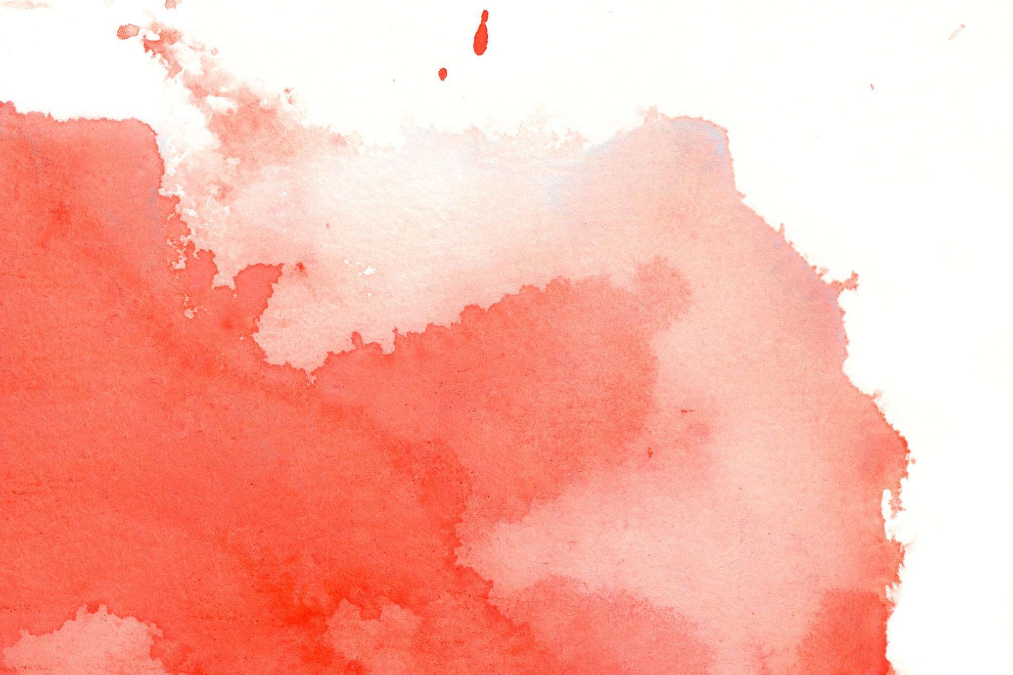 「紙に染み込む赤い水彩絵の具」