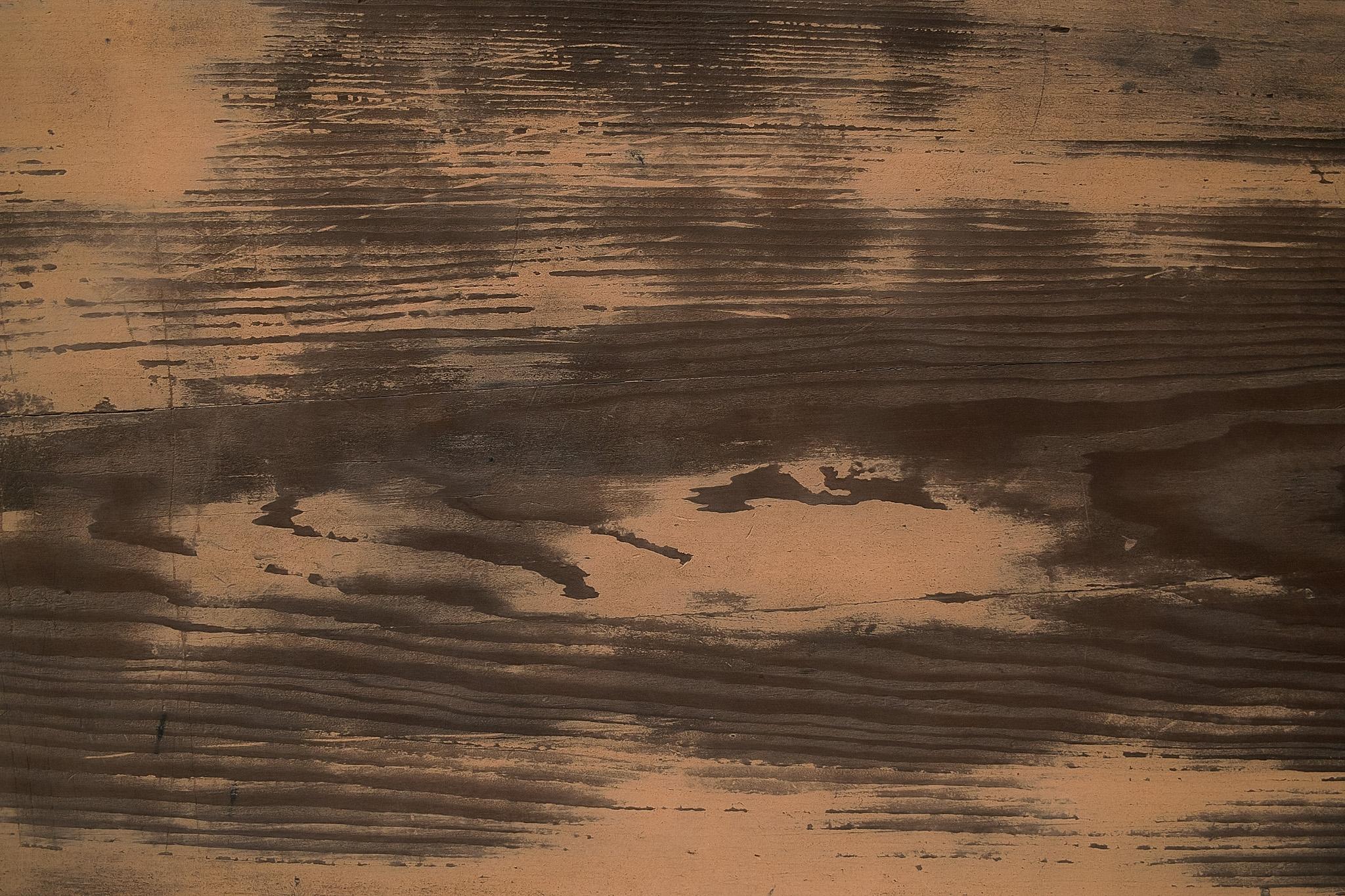 土のついた和風の板
