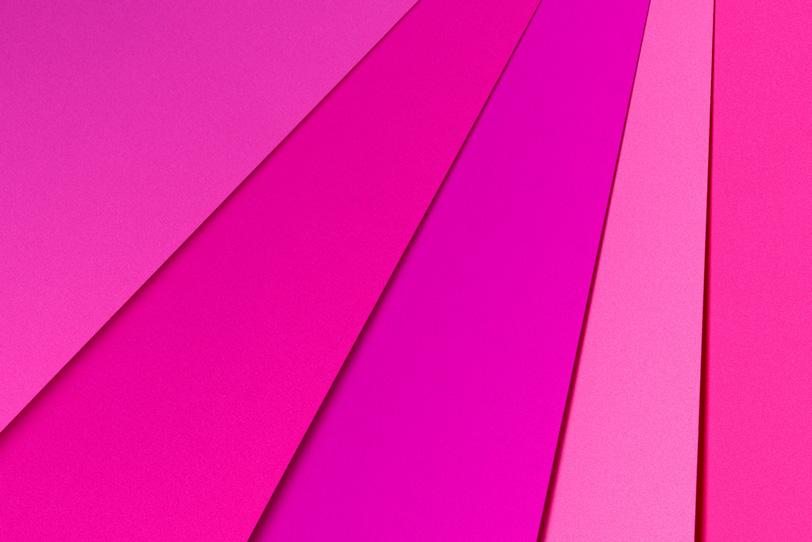 鮮やかなピンク系の背景の写真画像