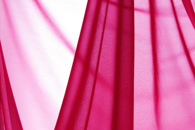 薄いピンク色の布地の写真画像