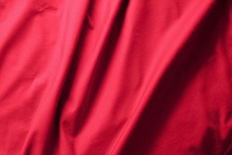 赤色の布のバックグラウンドの写真画像