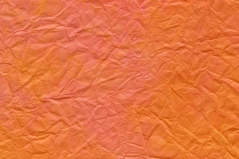 皺が入った橙色の揉染め和紙の写真画像
