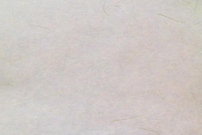 細い筋がある生成り色の和紙の写真画像
