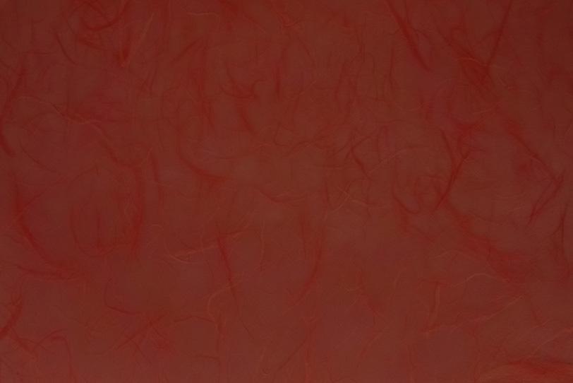 楮の筋のある弁柄色の和紙の写真画像