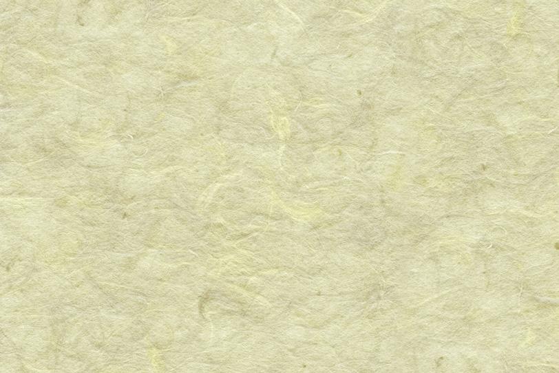 楮の質感が浮き出た淡黄蘗の和紙の写真画像