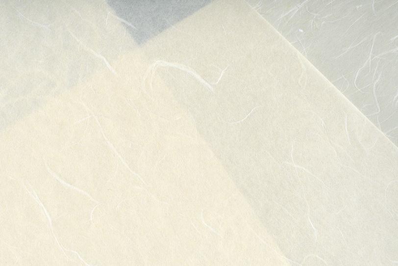 白色と灰色の重なった和紙の写真画像