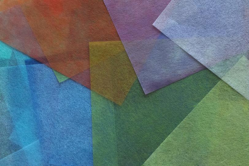 寒色系の薄い和紙のテクスチャ背景の写真画像