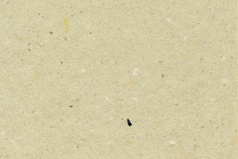黄蘗色に様々なテクスチャが混ざりあった和紙の写真画像
