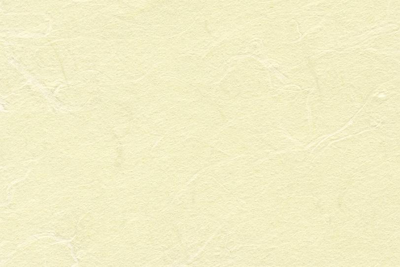 薄黄色のザラザラとした和紙の写真画像