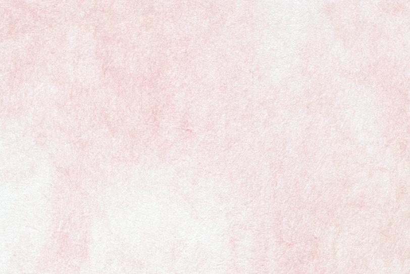 淡い紅色が滲む白い和紙の写真画像