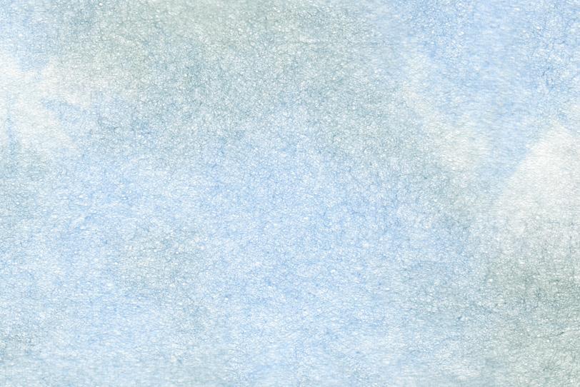 淡い水色に緑の滲みがある和紙の写真画像