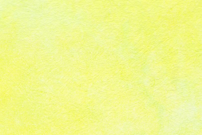 細かな皺のある檸檬色の和紙の写真画像