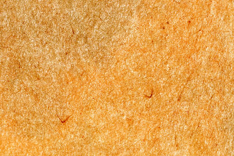 かすれた淡い飴色の和紙の写真画像