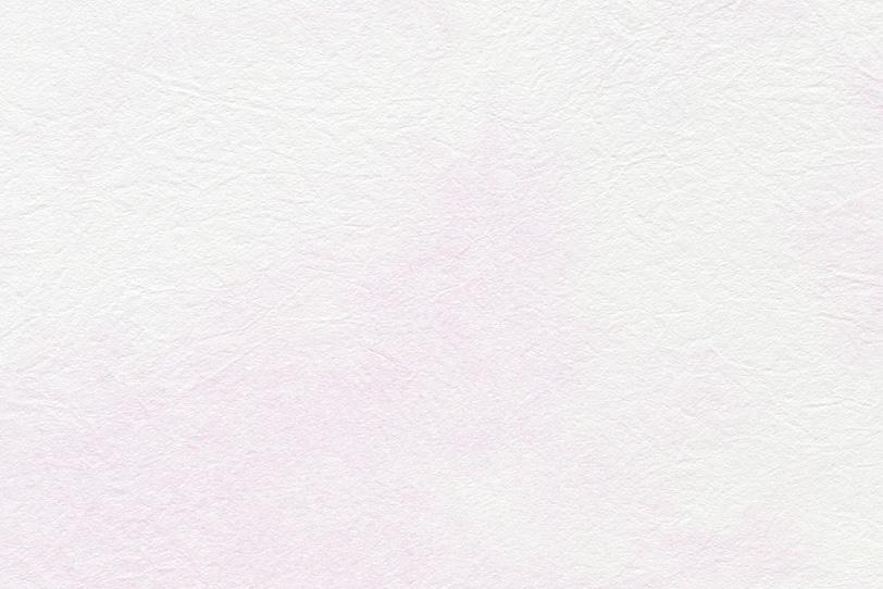 白の紙に薄いピンクが滲む和紙の写真画像