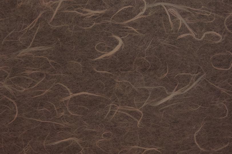 雲竜模様が入った黒茶色の和紙の写真画像