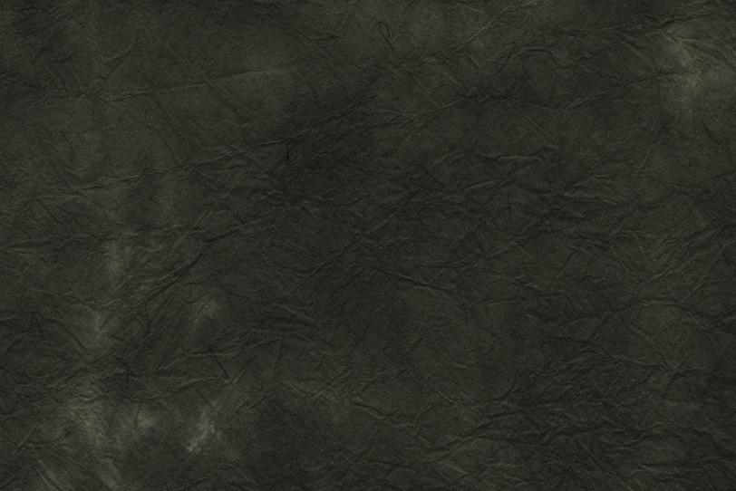黒墨のような蝋色の揉染和紙の写真画像