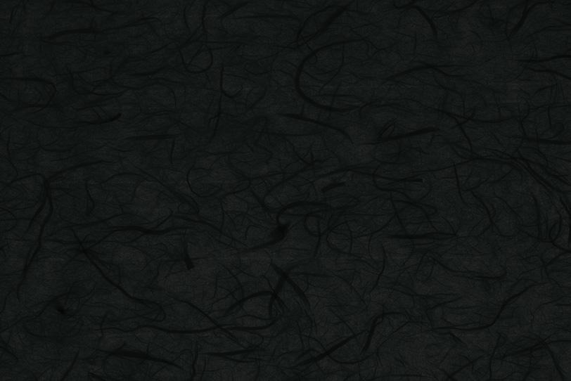 黒の筋模様が斑に入った和紙の写真画像