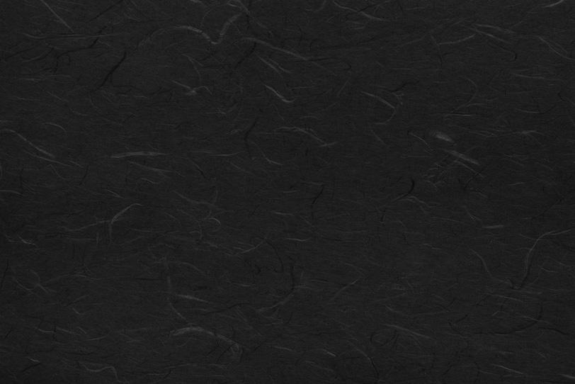 雲龍模様の黒紅色の和紙の写真画像