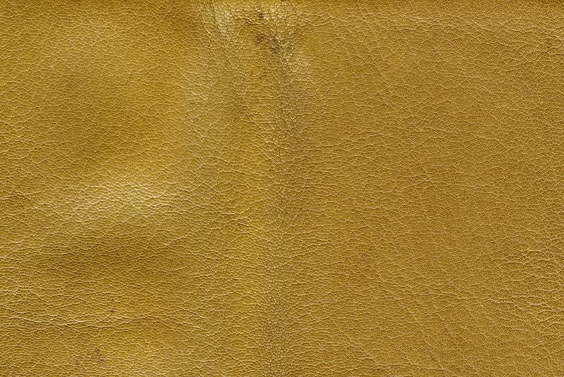 黄色に染められた革のテクスチャの写真画像