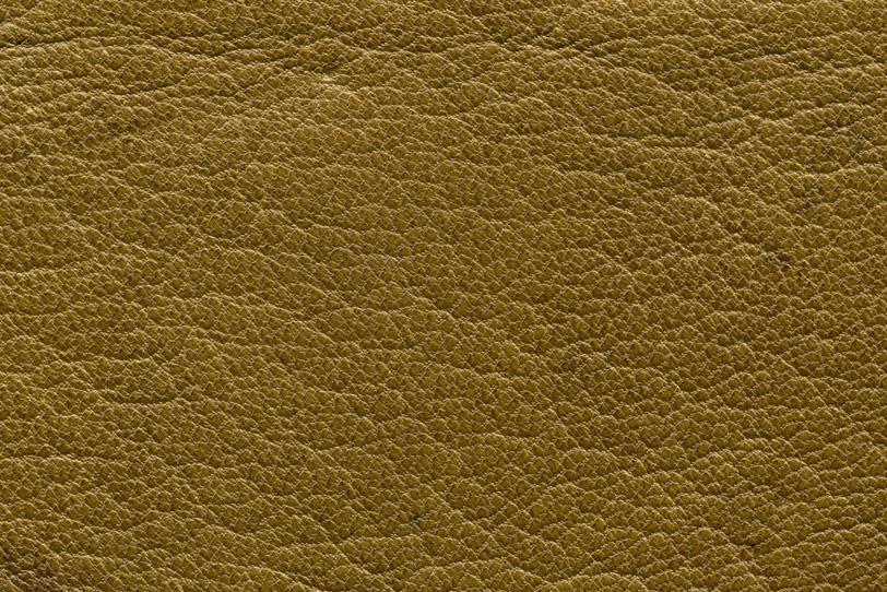 黄土色のレザーの表面の写真画像