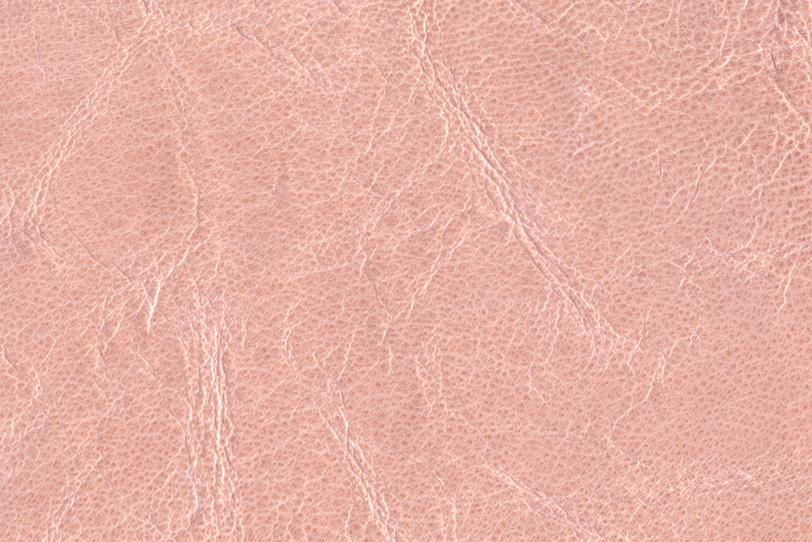 シワの入ったピンクの革の写真画像