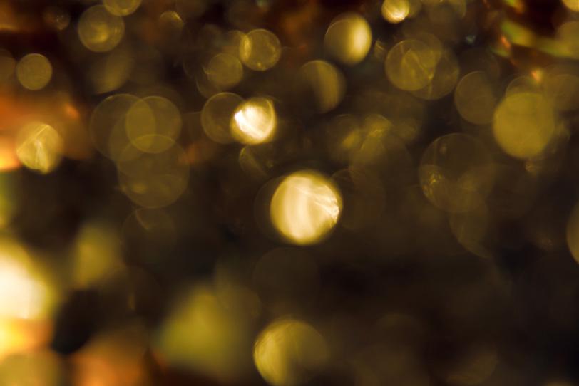 「ゴールドの光のボケ」の素材を無料ダウンロード