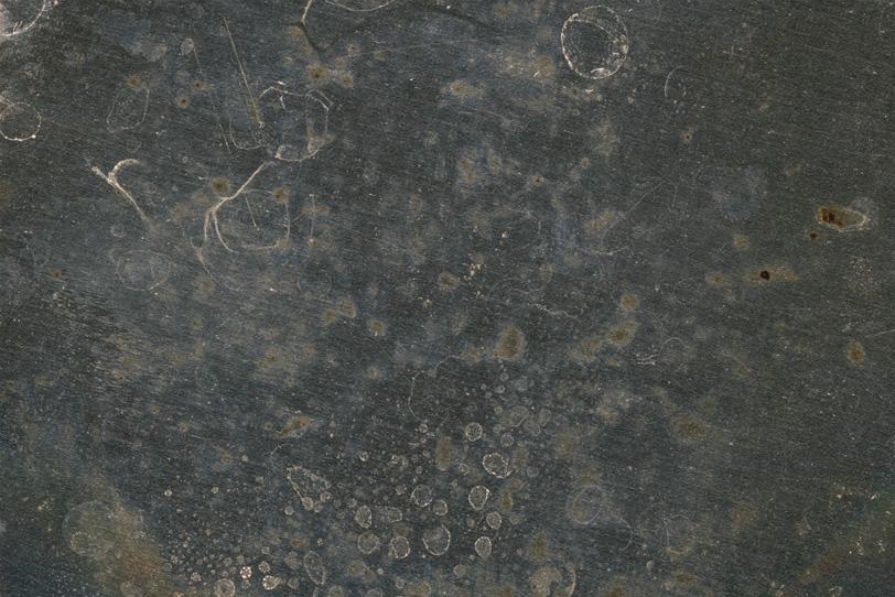 使い古されたマテリアルが残る鉄板の写真画像