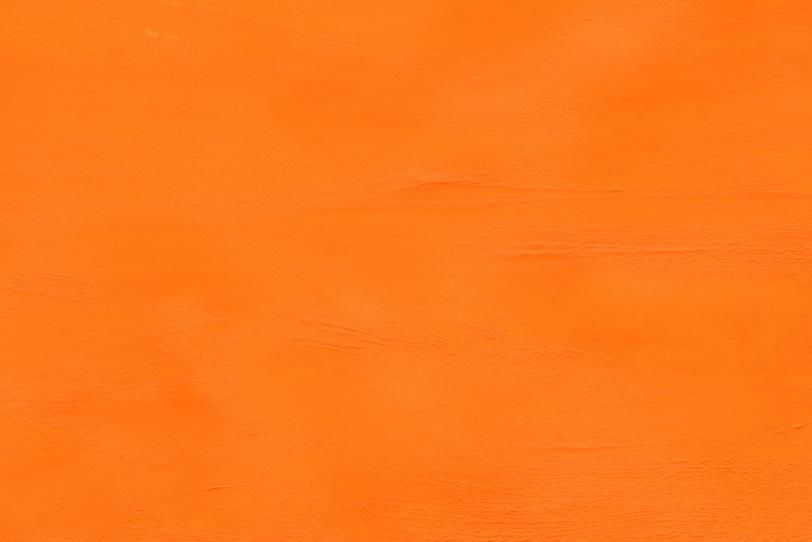 シンプルなオレンジ色の無地の背景