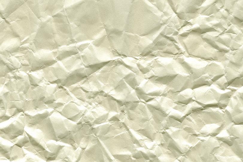 硬いシワが無数についた紙の写真画像