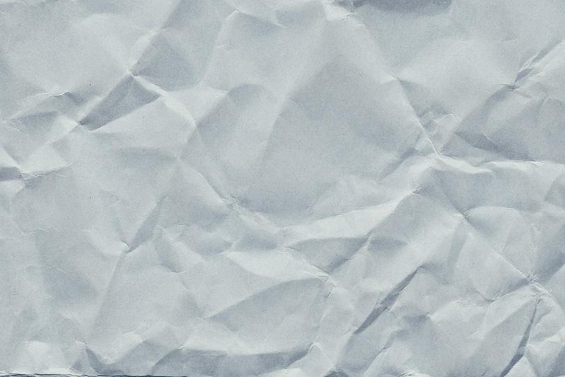 グレーの厚手紙のシワの写真画像
