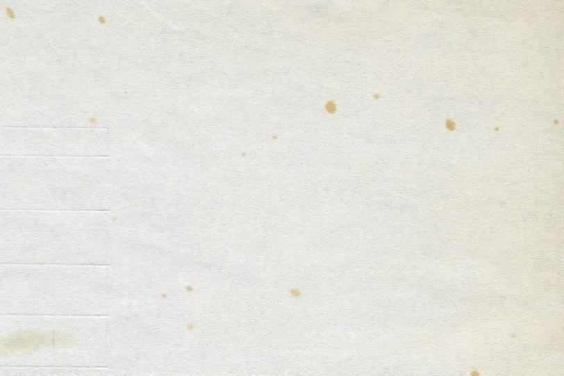 所々にシミのある古い紙の写真画像