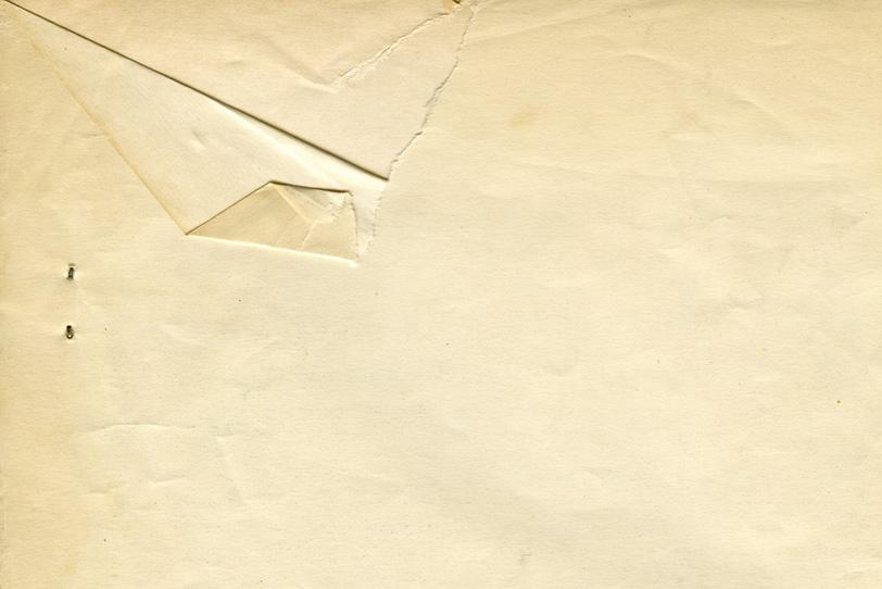 レトロな破けた紙のテクスチャの写真画像