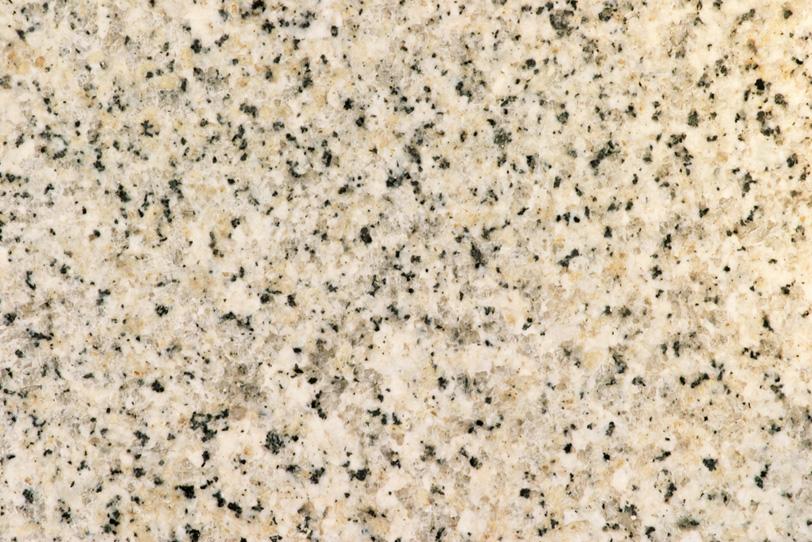 白に黒い点々がある石の写真画像